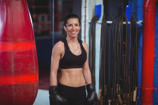 Smiling female boxer with boxing gloves