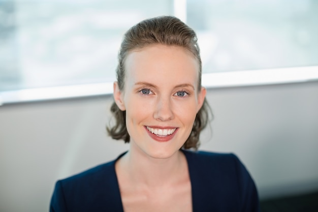 Smiling female business executive sitting in office