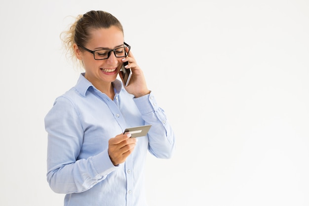 Smiling female card holder calling support service