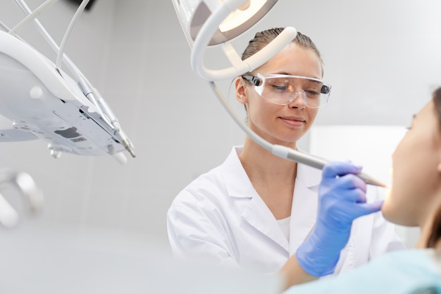 Smiling female dentist at work
