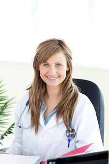 Smiling female doctor looking at the camera