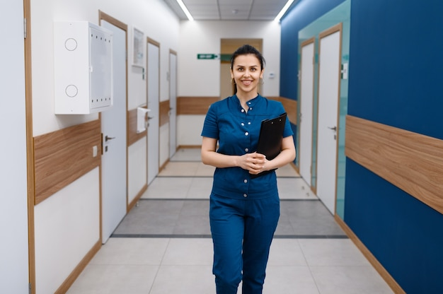 Smiling female doctor poses in clinic
