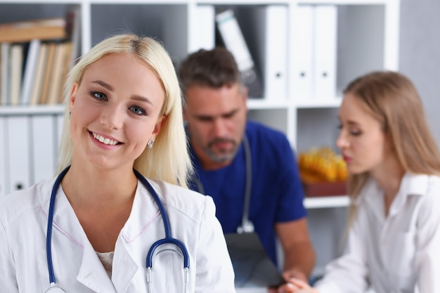 Smiling female doctor stand in office