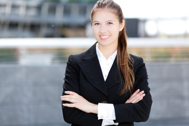 Smiling female manager in urban setting