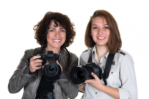 Smiling female photographer with two professional cameras isolated