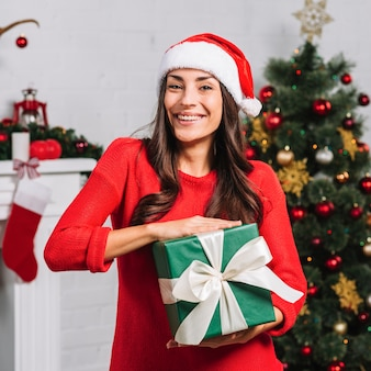 Smiling female with green gift box