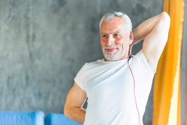 Smiling fit senior man exercising
