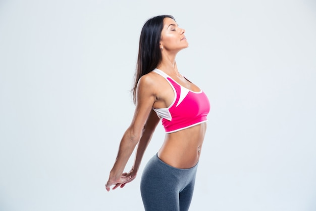 Smiling fitness woman stretching hands