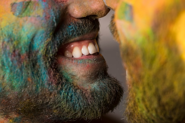Smiling gay couple in holi powder