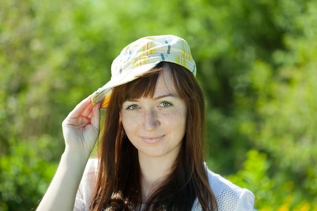 Smiling girl in cap