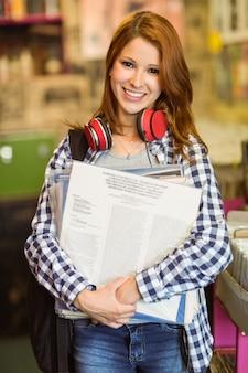 Smiling girl holding some vinyls