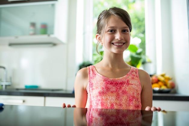 Smiling girl in kitchen