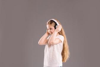 Smiling girl listening to music