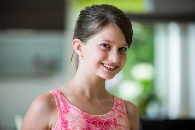 Smiling girl in living room
