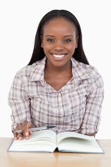 Smiling girl reading a novel