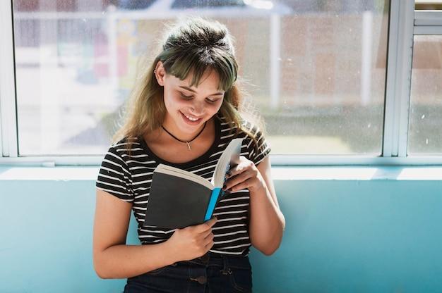 Smiling girl reading in school