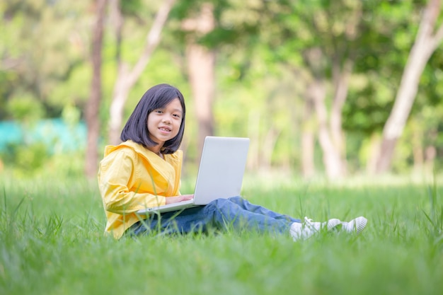 Smiling girl sitting on the grass