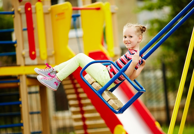 Smiling girl on swing