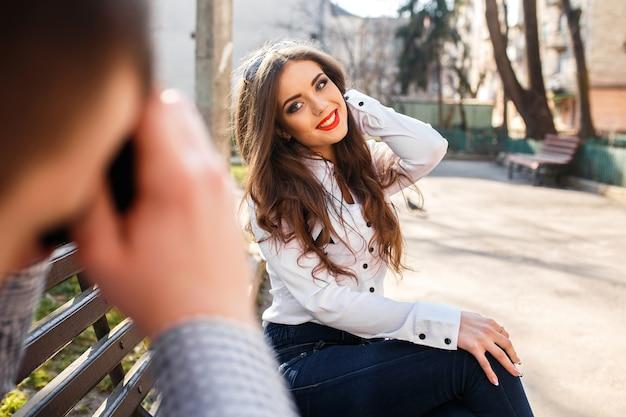 Smiling girl touching her hair