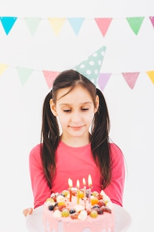 Smiling girl with a birthday cake