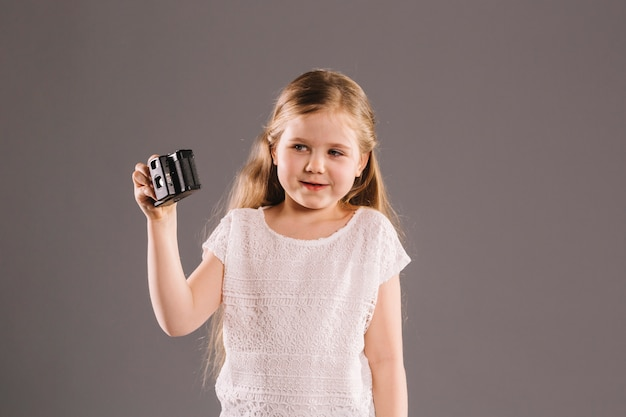 Smiling girl with camera