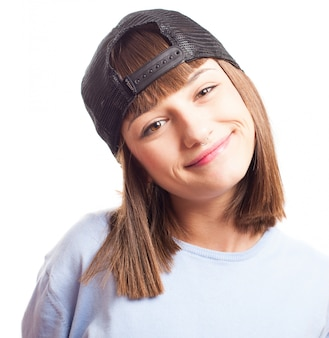 Smiling girl with a cap