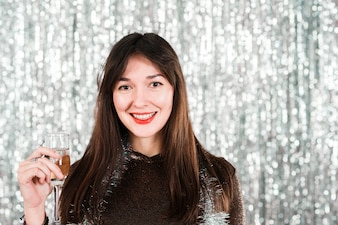 Smiling girl with drink in new year party