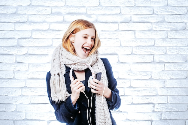 Smiling girl with headset and phone