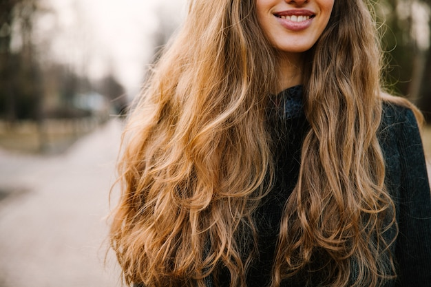Smiling girl with long hair