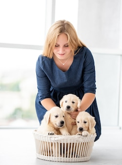 Smiling girl with puppies
