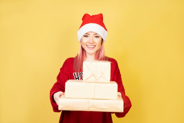 Smiling girl with red santa suit 2