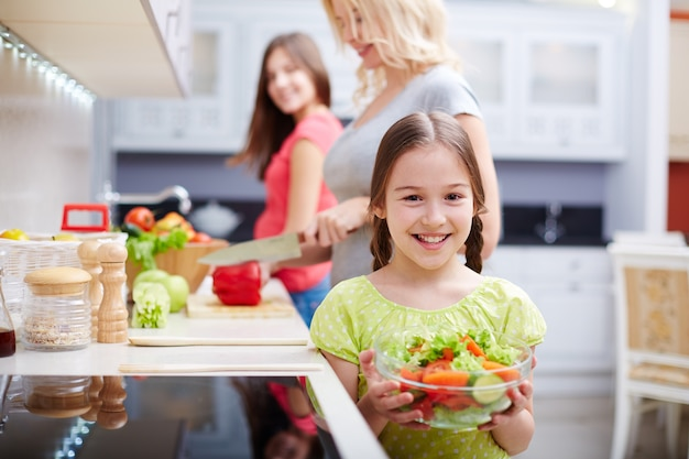 Smiling girl with salad