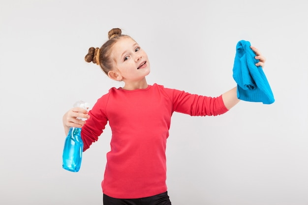 Smiling girl with a spray and a blue rag