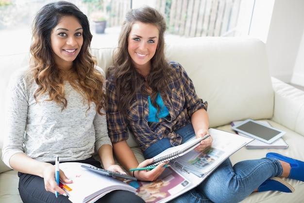 Smiling girls checking a calculator