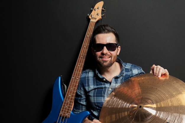 Smiling guitarist with cymbal