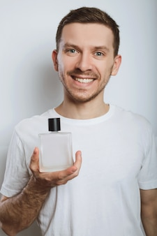 Smiling guy and perfume