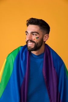 Smiling guy with lgbt flag