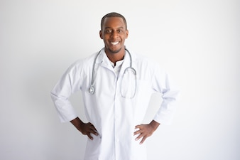 Smiling handsome young black male doctor. Medicine concept.