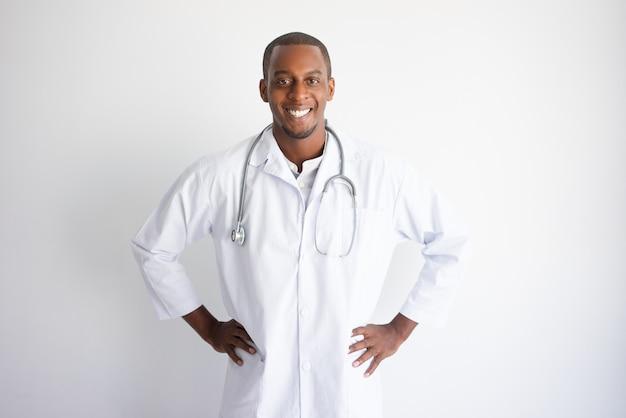 Smiling handsome young black male doctor. medicine concept.