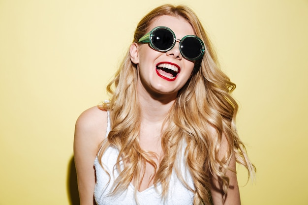Smiling happy blonde woman wearing sunglasses