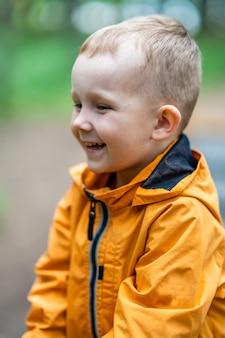 Smiling happy kid enjoying park outdoors