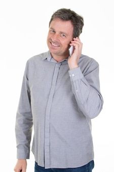 Smiling happy man talking on the phone