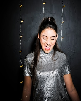 Smiling happywoman in silver dress