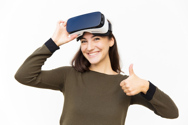Smiling happy woman taking off vr headset