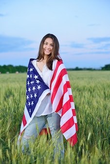 Smiling happy woman with the american flag