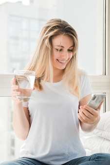 Smiling healthy girl with glass of water