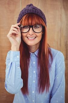 Smiling hipster woman looking at camera