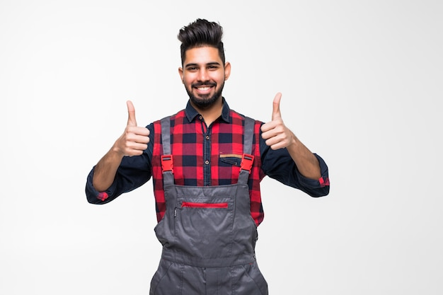 Smiling indian man worker thumbs up on white space