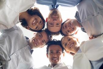 Smiling international business team huddling