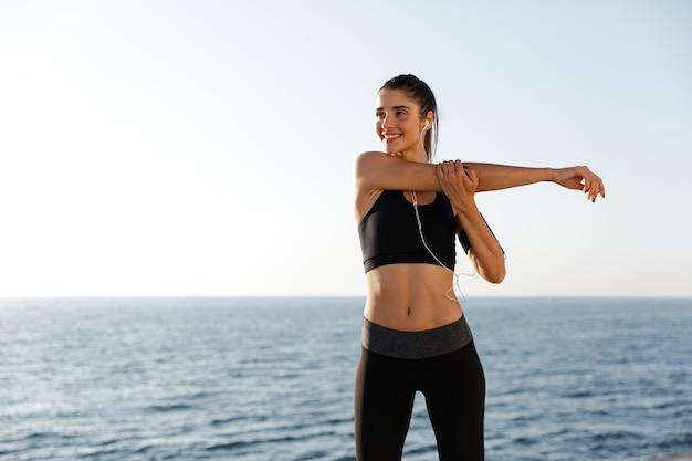Smiling lady making exercises while training